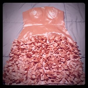 Peach summer party dress with detail at bottom